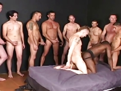 black dude boneed nakedback by nine men in a tight bukkake.