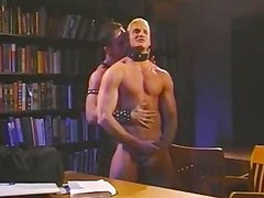 Vintage Muscled mans In Leather Stretching pooper In Quiet Library