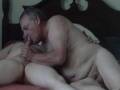 Two mature Bears on a bed