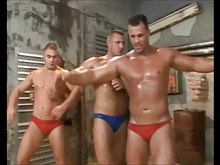 Four guys Wrestling And banging.