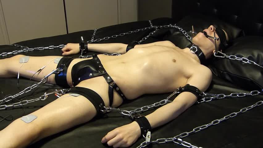 man Comes Proudly With his new Set Of Shiny Latex Restraints. he Doesn't Know Until Late That Their Efficacy Will Be Checked With painful Electro On T