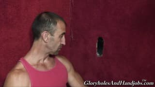 An older fellow enjoys sucking penis through A Gloryhole