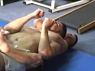 two White Wrestling In Gym