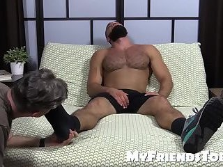 brawny Ricky Larkin stroking Off whilst Toes Are Sucked