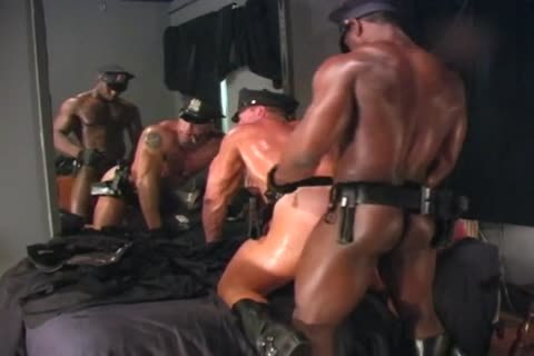 Two muscular Cops poke Each Other