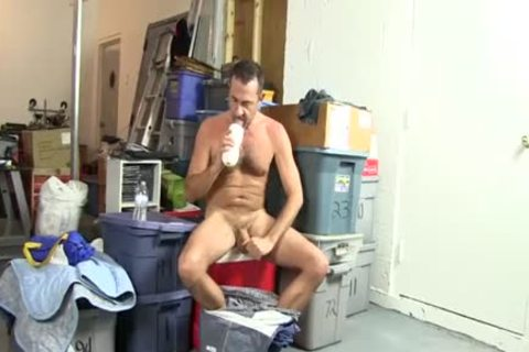Victor Beats Off With dildo In A Warehouse