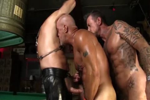 Leather Clad guys poke Each Other On The Pool Table
