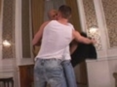 Two muscular men pound In Living Room