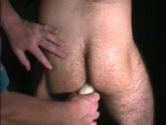 curly twink receives a handjob and played with a sextoy.