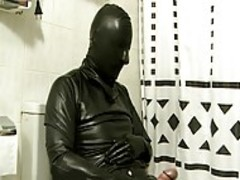 dude In dark Latex Catsuit Jacks Off In bathroom