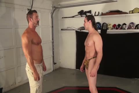 dad Wrestles Muscle Hunk Into Submission