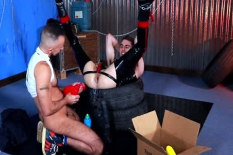 Fisted Rubber Gimp - FISTING And raw