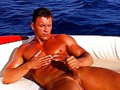 Muscle dude Masturbates On A Sail Boat